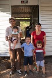 Oscar & Rosa, and their boys Freddy, Oscar, & Salvador, in front of their new home