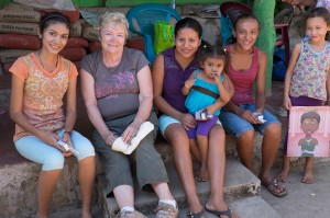 Lorraine enjoying time with the women and children sharing tooth brushes and toys